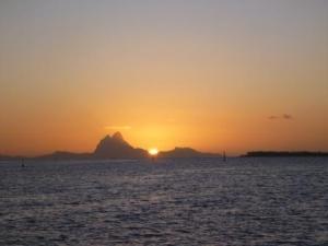 sun setting behind Bora bora