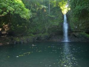 Julia swimming in waterfall pool Savaii