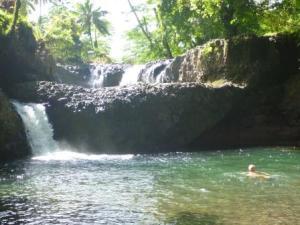 swimming in waterfall pool