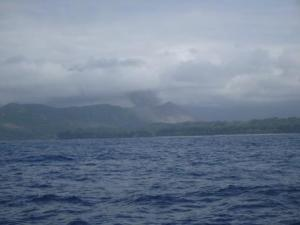 approaching Tanna with smoking volcano visible